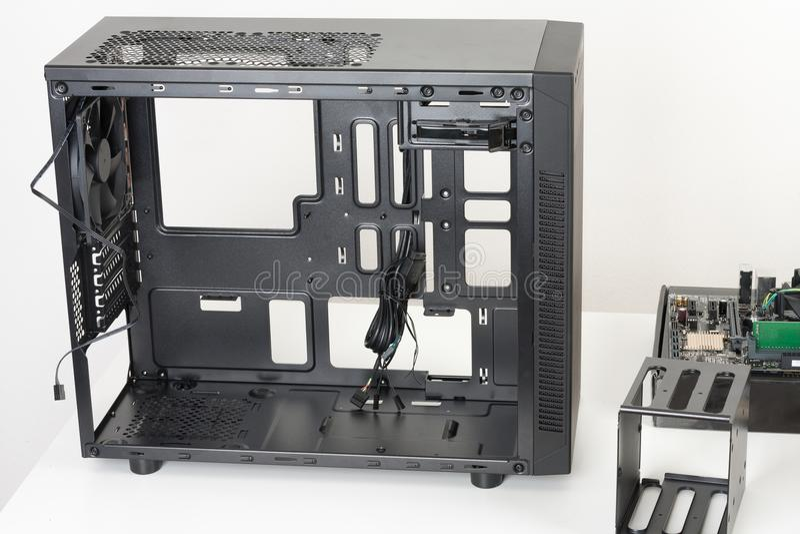 Empty black computer case, midi tower for micro ATX motherboard stock image