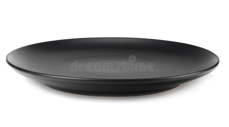 Empty black round plate isolated on a white background royalty free stock images