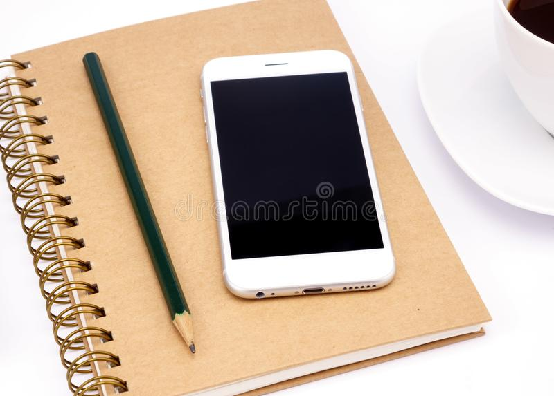Empty screen of smartphone and notebook royalty free stock photo