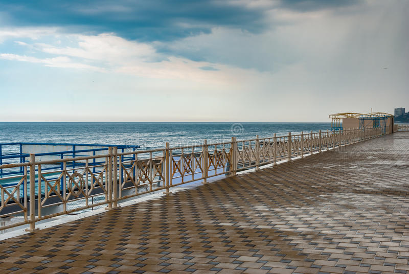 Empty Black Sea-front in the central part of Alushta city. Alushta, Ukraine - May 21, 2013:Empty Black Sea-front in the central part of Alushta city after rain royalty free stock photo