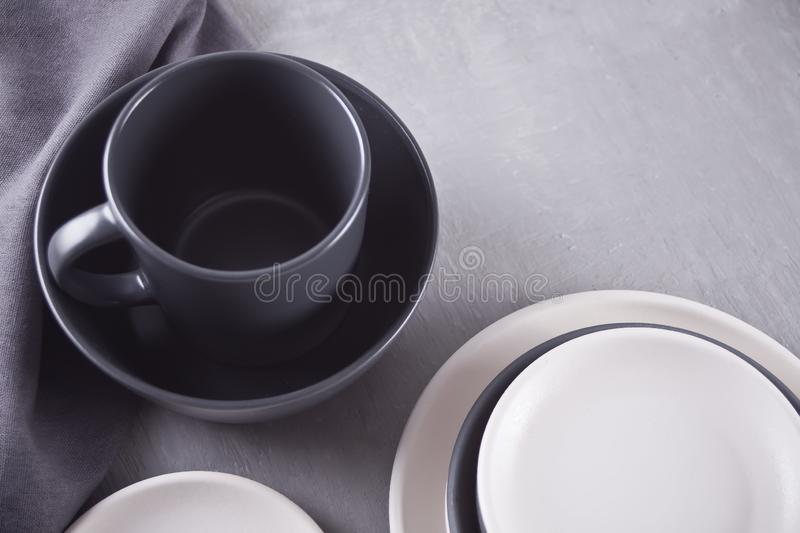 Empty black and white plates over gray table. Asian kitchen oriental traditional minimalism pottery empty food and soup black and white ceramic plates on the stock image