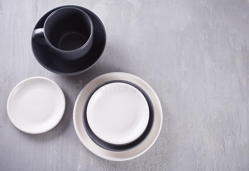 Empty black and white plates over gray table. Asian kitchen oriental traditional minimalism pottery empty food and soup black and white ceramic plates on the royalty free stock photos