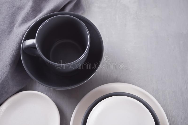 Empty black and white plates over gray table. Asian kitchen oriental traditional minimalism pottery empty food and soup black and white ceramic plates on the royalty free stock images