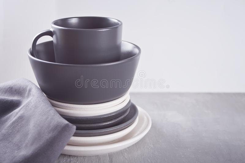 Empty black and white plates over gray table. Asian kitchen oriental traditional minimalism pottery empty food and soup black and white ceramic plates on the stock photos