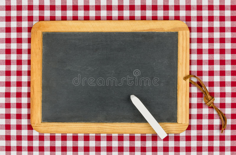 Empty Blackboard With Chalk On A Checkered Table Cloth Royalty Free Stock Image