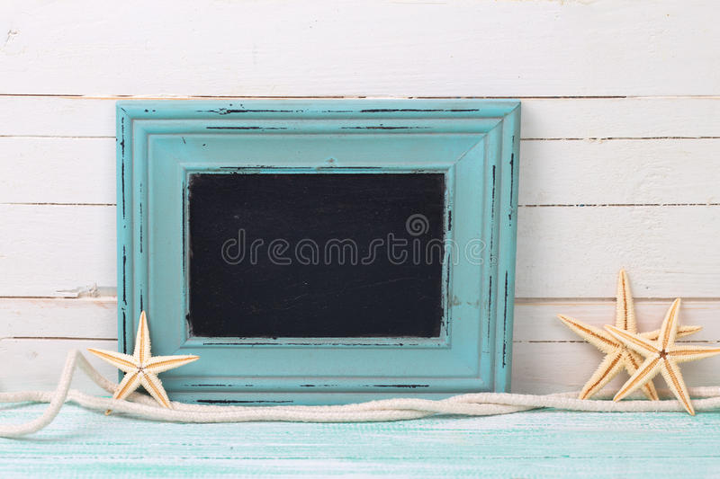 Empty blackboard and marine items royalty free stock photography
