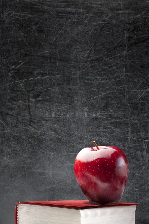 Empty Blackboard Red Apple Book stock images