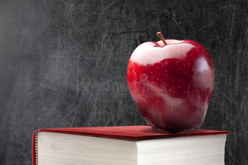 Empty Blackboard Red Apple Book royalty free stock photography