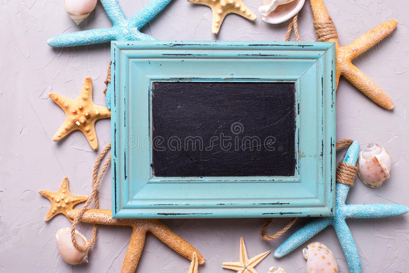 Empty blackboard for text and marine items on grey background. Sea objects. Selective focus. Place for text royalty free stock image