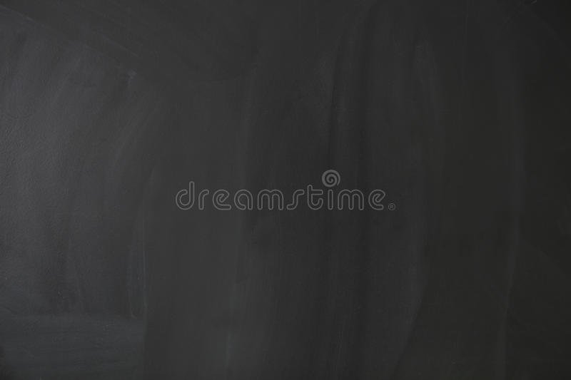 Empty blank black chalkboard with chalk traces stock photography