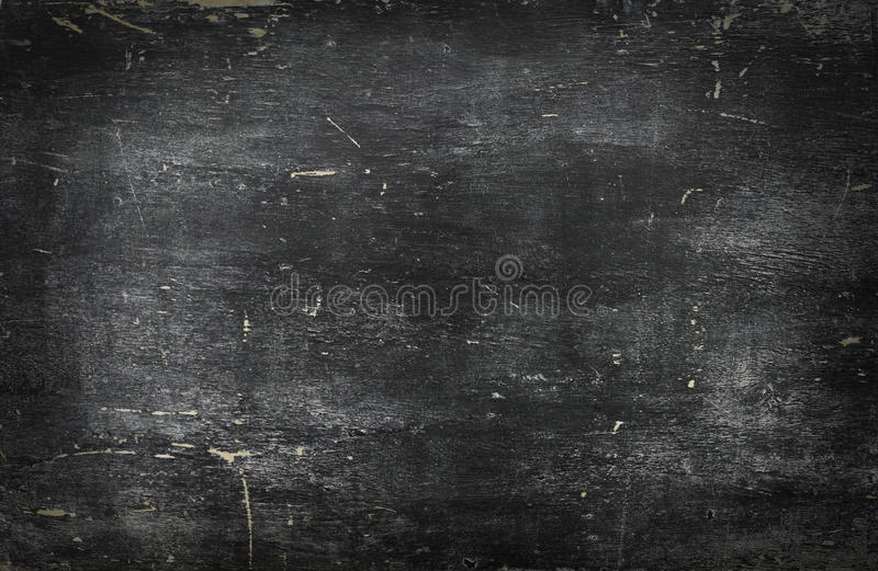 Empty blank black chalkboard with chalk traces. Empty blank black chalkboard background with chalk traces royalty free stock images