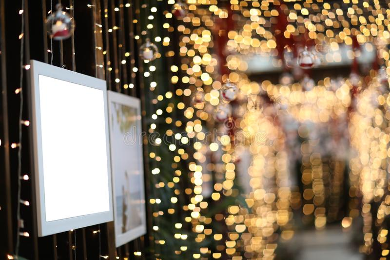 Empty blank photo frame in christmas decorated defocused background stock images