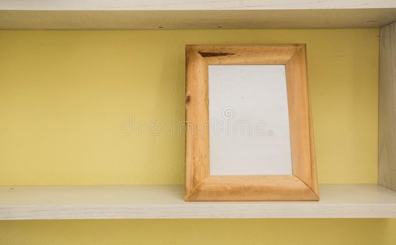 Empty blank vintage picture frame with yellow wall royalty free stock image