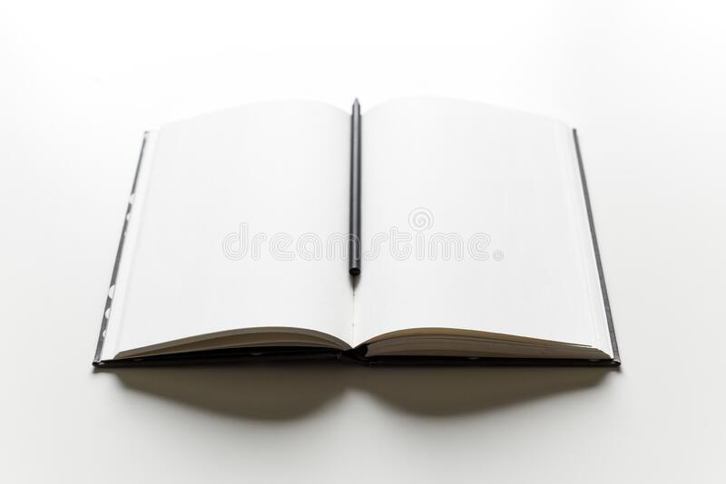 Empty blank white page in a paper note book with pencil for writing ideas and notes. Empty blank white page in a paper note book with pencil stock images