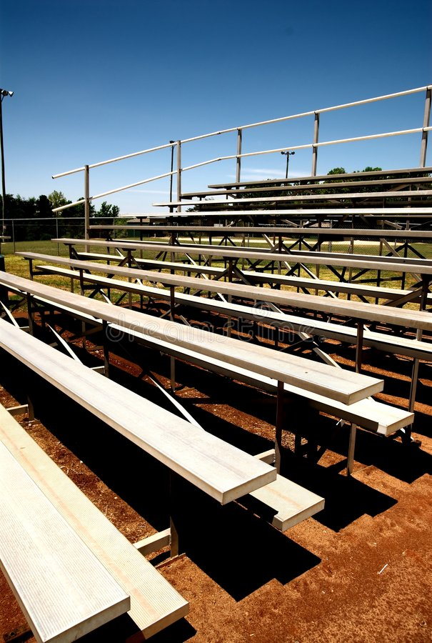 Empty bleachers stands. Empty bleachers with no people at a baseball game stock photography