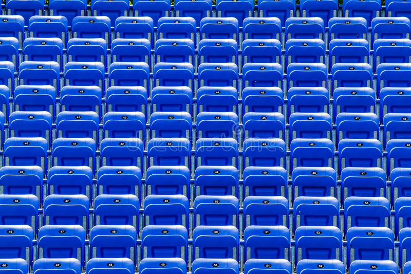 Empty Blue Bleachers. Outdoors with Numbers - Nobody royalty free stock photo