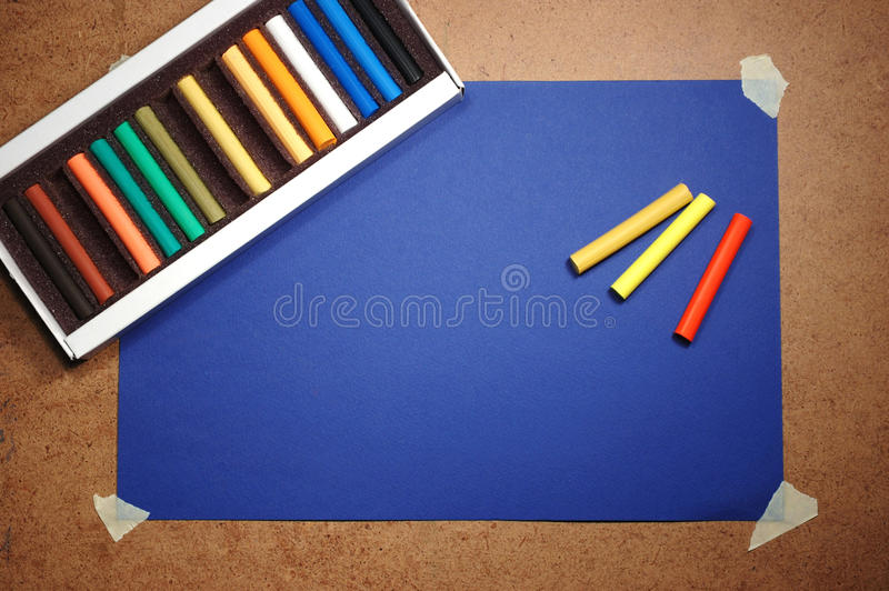 Empty blue cardboard background and pastel stock image