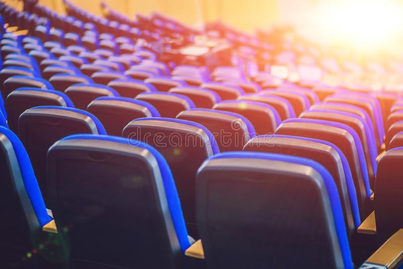 Empty blue chairs at cinema or theater or a conference room stock images