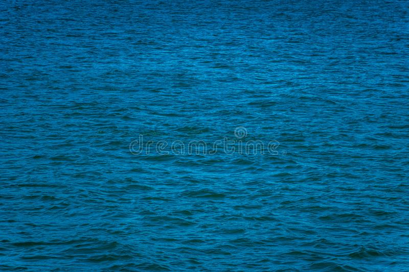 Empty Blue Ocean, Calm Seas With Copy Space. Deep blue sea color with calm waves, room for text stock images