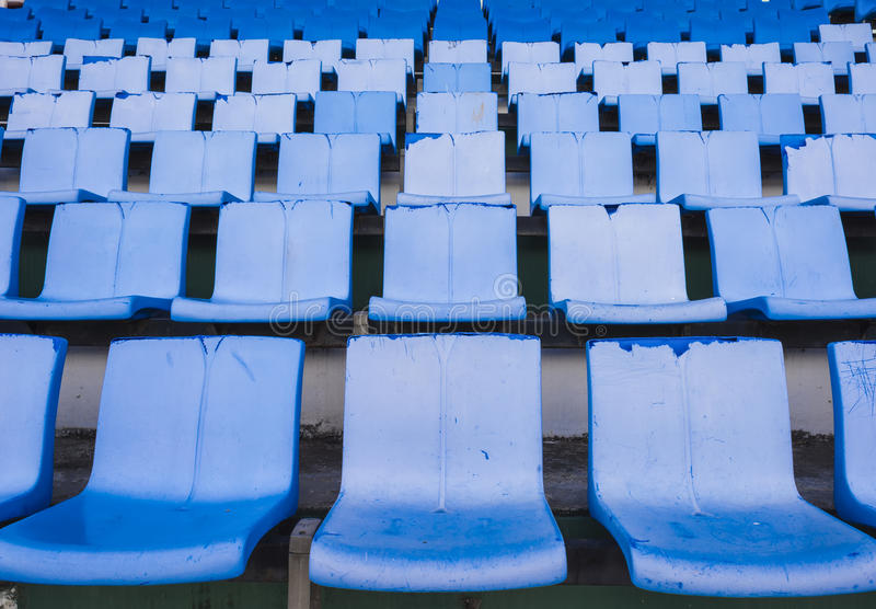 Empty blue seats or chair rows in stadium. Empty blue seats rows in stadium stock images
