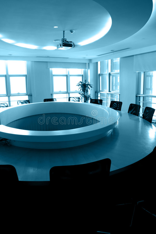 Empty boardroom with round table royalty free stock image