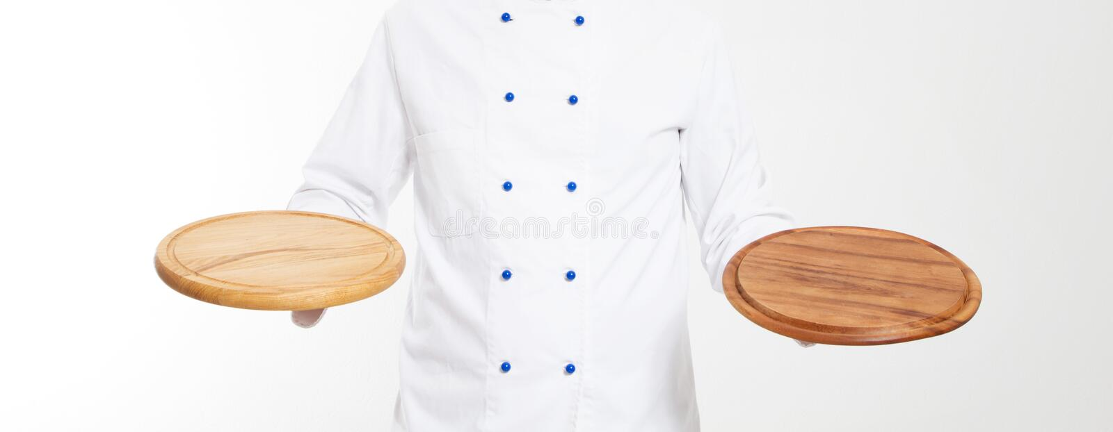 Empty boards for pizza in the hands of the chef isolated royalty free stock images