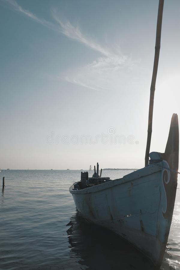Empty boat in the sea stock photos