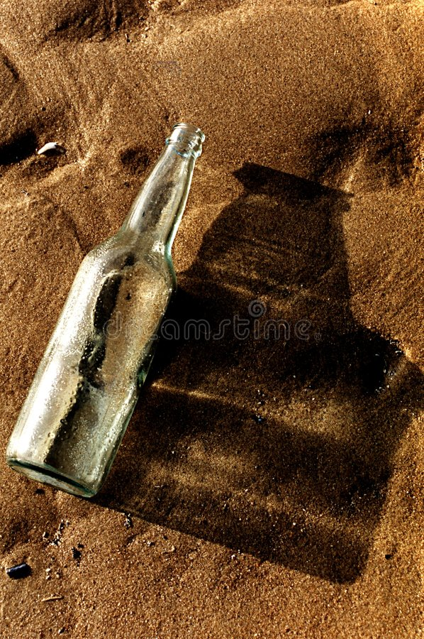 Free Empty Bottle On The Sand Royalty Free Stock Image - 8121126
