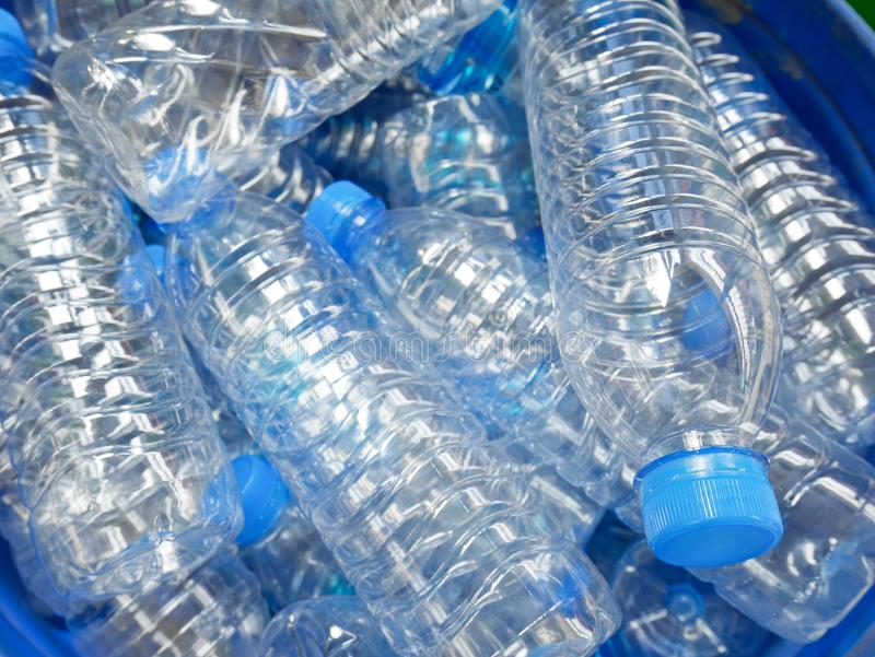 Empty bottled water in big bucket. For recycling royalty free stock photo