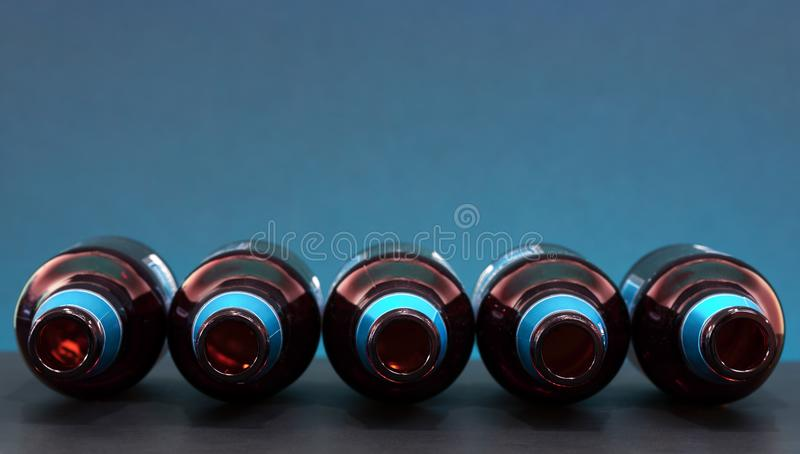 Empty bottles positioned horizontally – top view. Drink or social media network concept. Empty bottles positioned horizontally. Drink or social media stock images