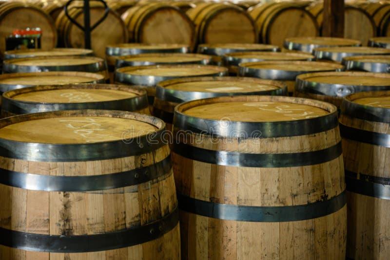 Empty Bourbon Barrels Await Filling stockbild