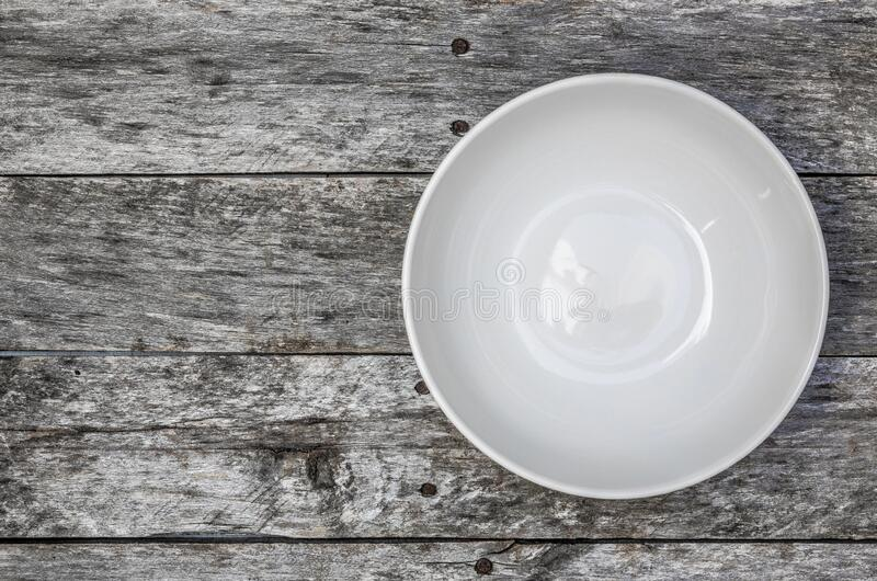 Empty bowl on gray wood top view stock photography
