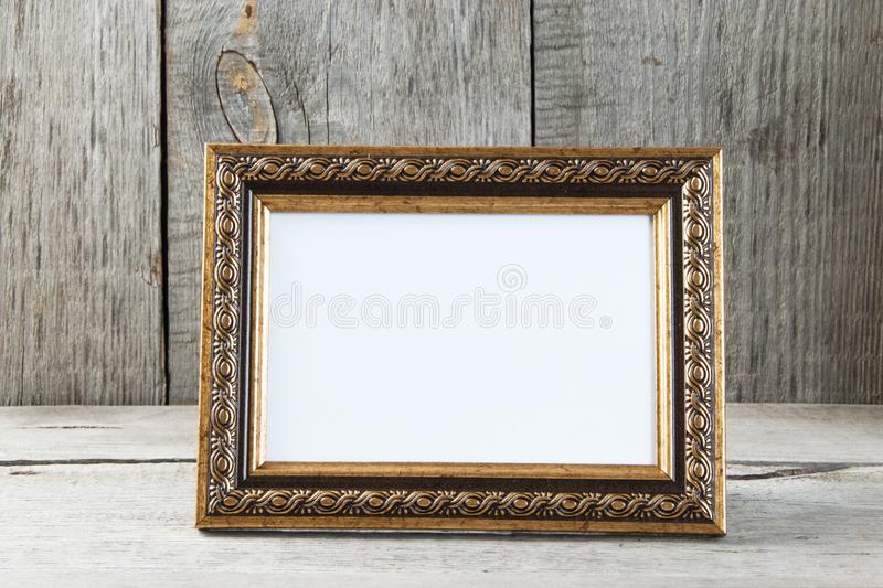 Empty picture frame on wooden background. royalty free stock images