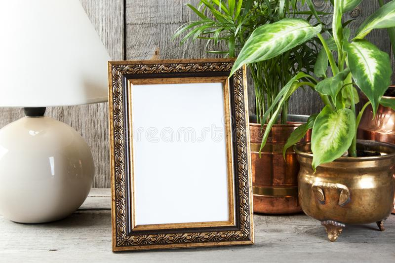 Empty brass picture frame on wooden background. stock photography
