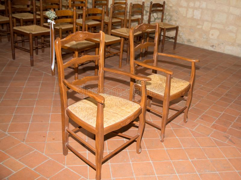 Empty bride groom chairs in church for weeding royalty free stock images