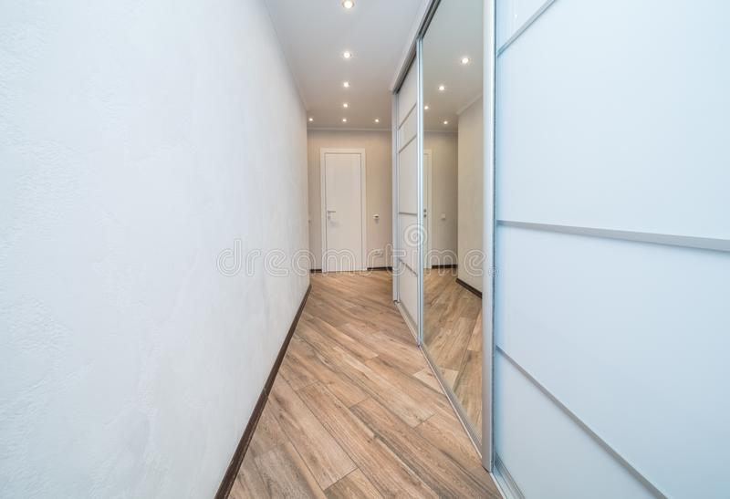 Empty bright entrance. In modern apartment with mirror royalty free stock image