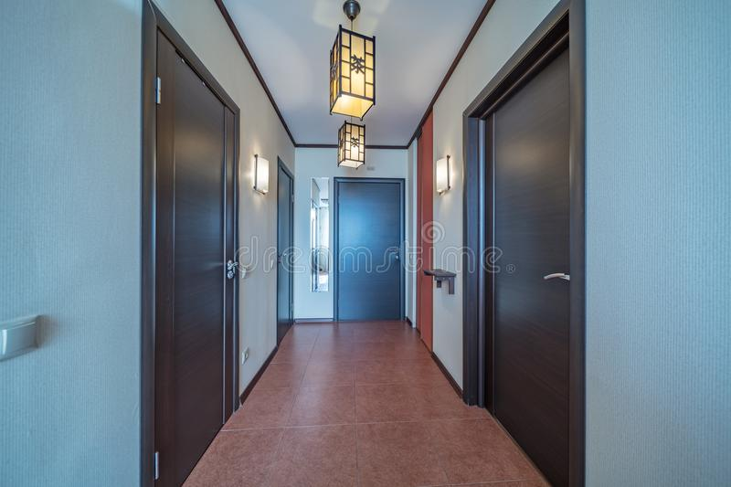 Empty bright entrance. Empty entrance in modern apartment with mirror royalty free stock image