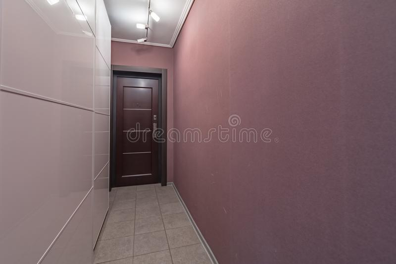 Empty bright entrance. Empty walls entrance in modern apartment with mirror royalty free stock photo
