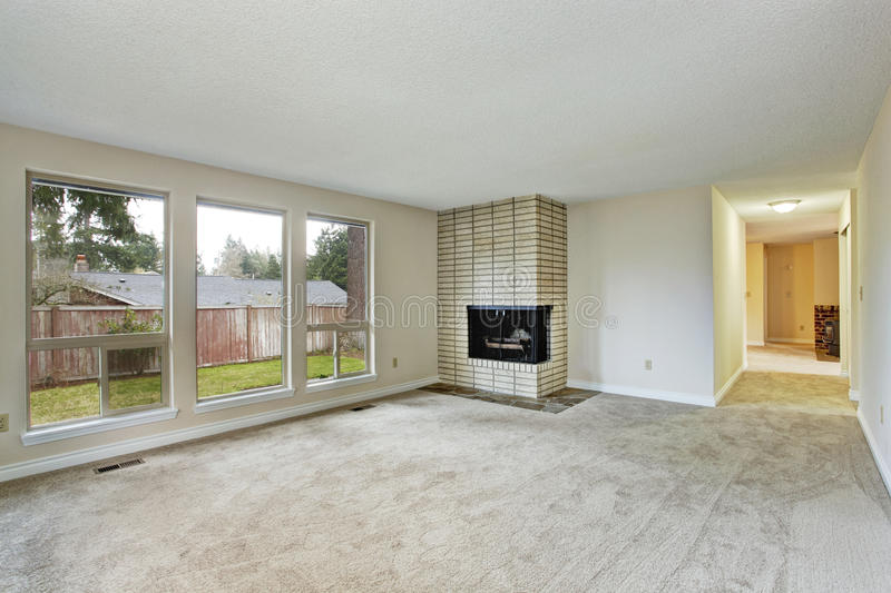 Empty bright living room with fireplace stock photos