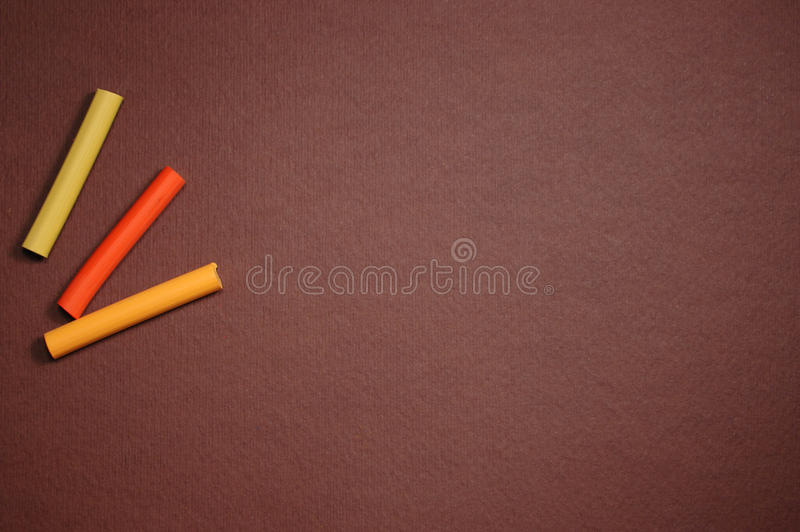 Empty brown cardboard and multicolored pastel stock photography