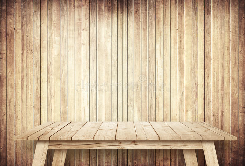 Empty brown table next to wooden wall stock photo