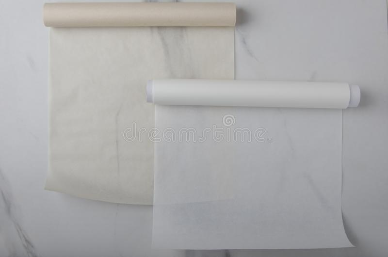 Empty brown and white baking paper on the kitchen desk stock photos
