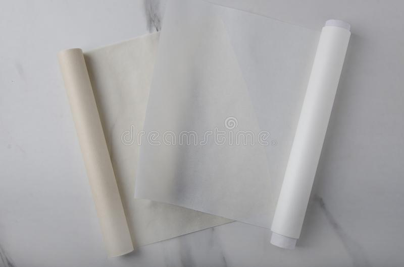 Empty brown and white baking paper on the kitchen desk stock image