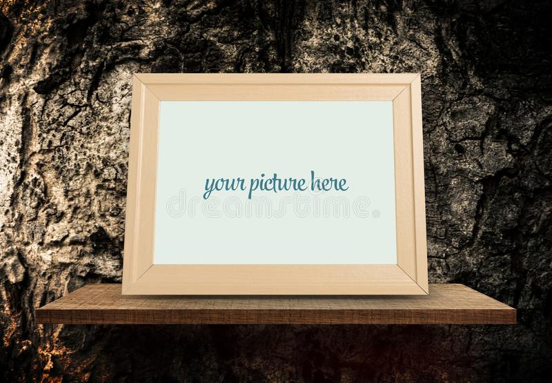 Empty Brown Photo frame with tree bark background royalty free stock photography