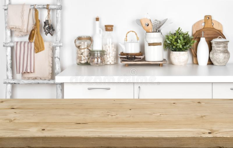 Empty brown wooden table with blurred image of kitchen interior royalty free stock images