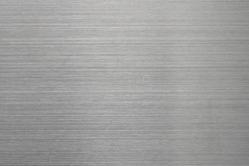 Empty brushed metal surface. Abstract background for design and backdrop.  stock photos
