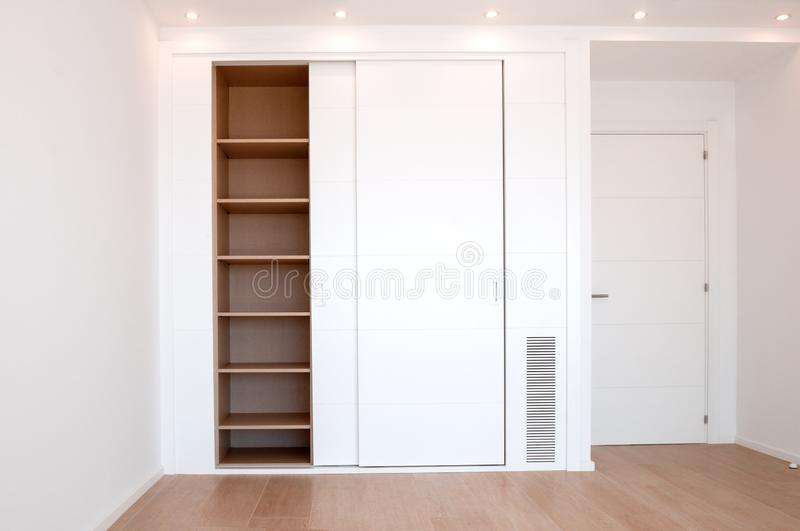 Empty built-in wardrobes. New house, empty rooms. Interior royalty free stock images