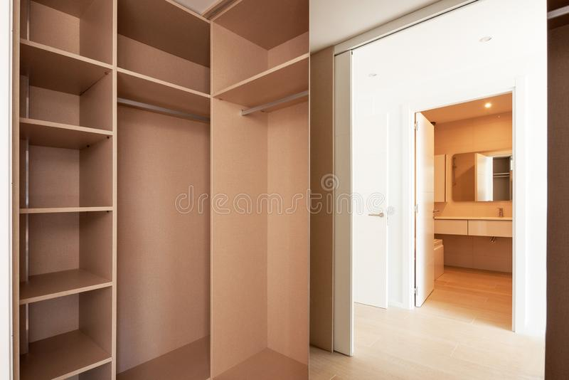 Empty built-in wardrobes. New house, empty rooms. Cupboard stock image