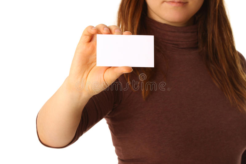 Empty business card in a female hand stock photo