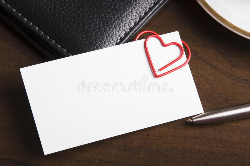 Empty business card and heart shaped paper clip stock photo image download empty business card and heart shaped paper clip stock photo image of paper colourmoves